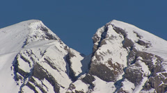 Mountain top in Swiss Alps near Grindelwald, Berner Oberland - pan - stock footage