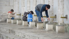 Young boys at the courtyard of the New Mosque (Editorial) Stock Footage