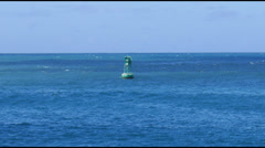 Green bouy at blue sea and sky Stock Footage