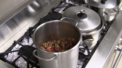 Uncovered cooking pans with soup Stock Footage