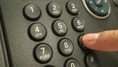 A close up of a phone and a hand calling the emergency number 999 Stock Footage