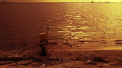 Small fishing boat on shore Stock Footage