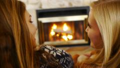 Over-Shoulder Shot Of Teen Girls Chatting In Front Of A Fireplace Stock Footage