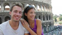 Tourist couple in Rome by Coliseum on travel Stock Footage