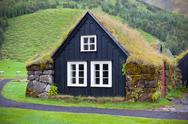 Stock Photo of overgrown typical rural icelandic house at overcast day