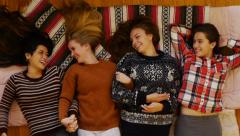 Directly Above: 4 Teen Girls Lying Down, Arm In Arm, Holding Hands, Chatting Stock Footage