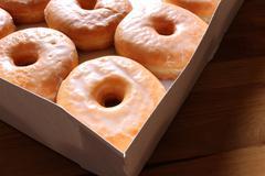 Irrestible Glazed Doughbuts - stock photo