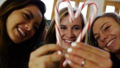 Teen Girl Framed By Friends In A Candy Cane Heart Blows A Kiss Stock Footage