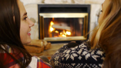 Looking Over The Shoulder Of Teen Girls Chatting In Front Of A Fireplace Stock Footage
