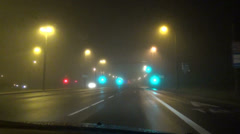 Traffic lights car driving on dense foggy early morning Stock Footage
