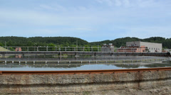 Panorama sewage waste water cleaning plant basin pool and birds Stock Footage