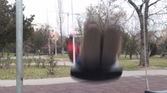 Young Female Swings In A Park Front-Shot Stock Footage