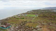 Flight along destroyed coastline after Haiyan Stock Footage