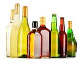 Stock Photo of bottles of assorted alcoholic beverages isolated on white background