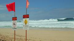 Ocean wave dangerous rip currents sign shore break Stock Footage