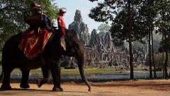 Tourists Riding Elephants at Ancient Bayon Temple in Angkor, Siem Reap, Cambodia Stock Footage