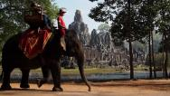 Stock Video Footage of Elephant Riding at Ancient Bayon Temple in Angkor, Cambodia