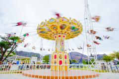 swing seat exciting amusement ride - stock photo