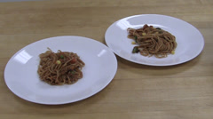 Two plates with pasta and vegetables Stock Footage