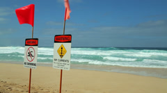 Ocean wave dangerous rip currents sign Stock Footage
