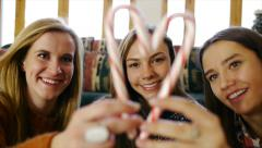 Friends Frame A Friend In A Candy Cane Heart & She Blows A Kiss Stock Footage
