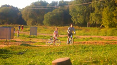 Man and Woman on the Bicycles at Sunny Day Stock Footage