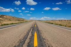 highway in wyoming desert - stock photo