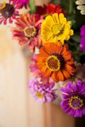 Bouquet of beautiful wild flowers in a wattled basket Stock Photos