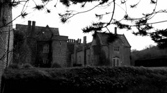 English mansion, dolly through trees (B&W dolly) - stock footage