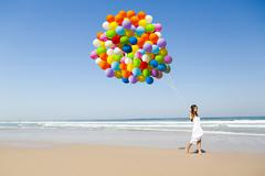 beauty walking with ballons - stock photo