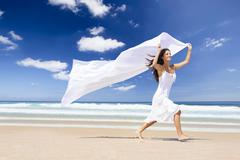 Jumping with a white scarf Stock Photos