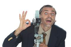 happy vintage camera man with super 8 movie camera - stock photo