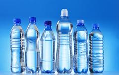 composition with assorted plastic bottles of mineral water - stock photo
