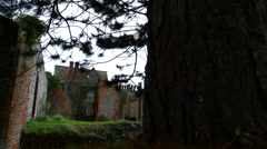 Behind a tree, an English mansion (dolly) - stock footage