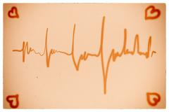 Electrocardiogram orange background Stock Photos