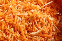 Grated carrots vegetables salad as background Stock Photos