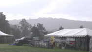 Stock Video Footage of rainstorm at the fair tents and landscape