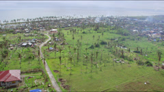 Aerial along devoted coast of rural town after typhoon Stock Footage