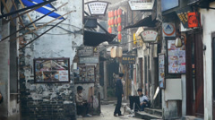 Traditional Chinese old town houses & street,some students drawing. Stock Footage
