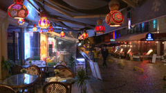 Rain falls at night outside a cafe in Istanbul, Turkey. Stock Footage