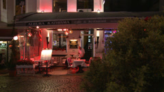 A night shot of a French cafe on a street in Istanbul, Turkey. Stock Footage