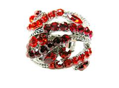 Shiny jewelry ring with red crystals Stock Photos