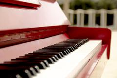 Stock Photo of Red Upright Piano