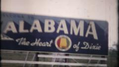 808 - roadside Alabama billboard at stateline - vintage film home movie - stock footage