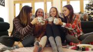 Stock Video Footage of Multi-Ethnic Group of Teen Girls Clink & Drink Hot Chocolate From Holiday Mugs