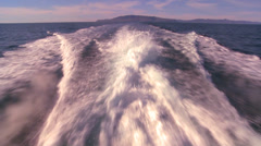 POV from the back of a boat motoring through the waters off Santa Barbara, - stock footage
