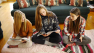 Stock Video Footage of Casually Dressed Teenage Girls, Reading Magazines, Digital Tablet (front view)