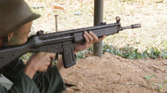 Firing HK33A1 assault rifle Stock Footage