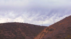 Scalloped clouds float above a hillside in California. - stock footage