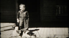 Farm boy and his dog on the front porch - 798 vintage film home movie Stock Footage
